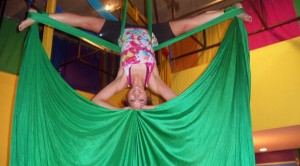 """Aerial silks  is an amazing art form that has increased my flexibility, vastly improved my strength, and combines grace, fluidity, movement, and laughter.  It is the most fun I have ever had 'working out.'   Karen C."